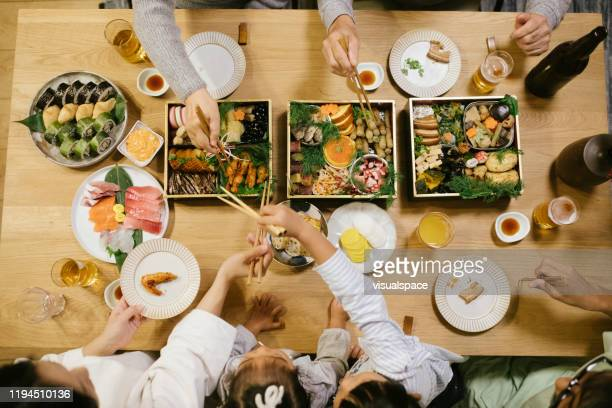 overhead shot of new year' day dinner table - new year's day stock pictures, royalty-free photos & images