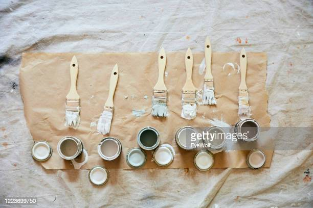 overhead shot of paint brushes and paint samples. - カーキグリーン ストックフォトと画像