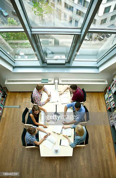 Overhead shot of six students studying at a table