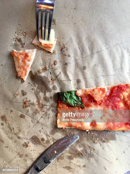 Overhead shot of slice of pizza with fork and knife