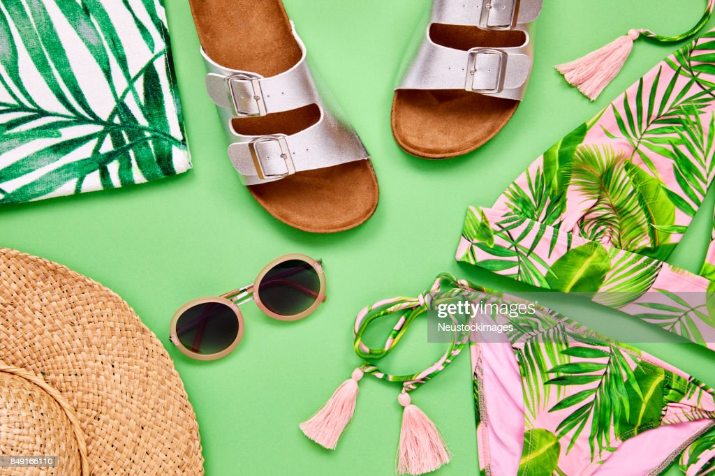Overhead shot of summer vacation accessories on green background : Stock Photo