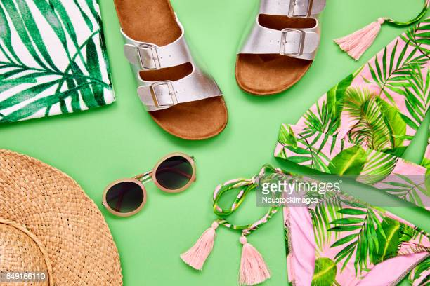 overhead shot of summer vacation accessories on green background - open toe stock pictures, royalty-free photos & images
