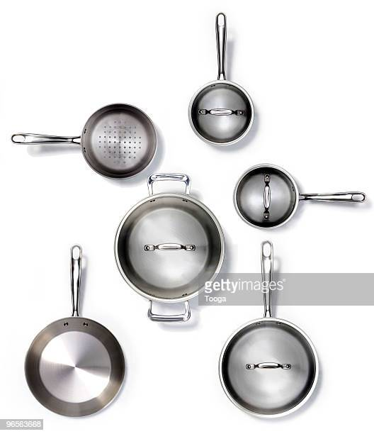 overhead shot of various pots and pans - cooking pan stock pictures, royalty-free photos & images