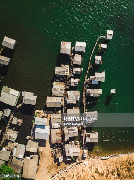 overhead shot of water village in port moresby - port moresby stock pictures, royalty-free photos & images