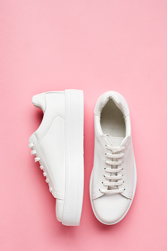 Overhead Shot Of White Sneakers On Pink Background 695474472
