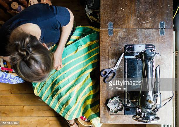 Overhead Shot Of Young Woman Sewing