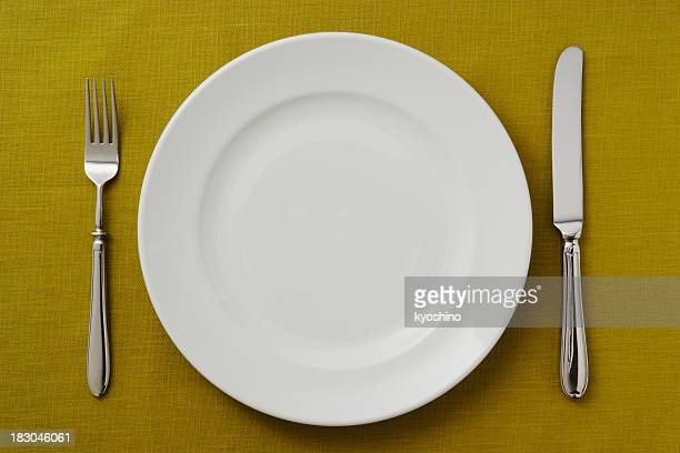 Overhead shot off place setting on green tablecloth