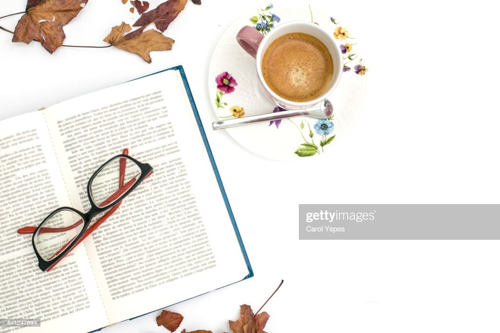 overhead shot open book and coffee with autumn leaves : Stock Photo