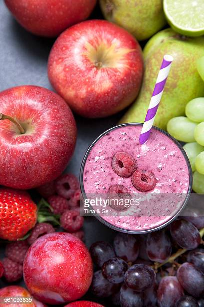 Overhead still life of fresh fruit and raspberry smoothie