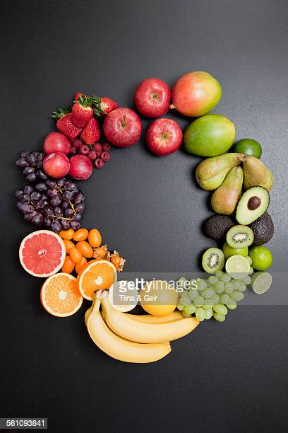 Overhead still life of variety of fresh fruit in circle