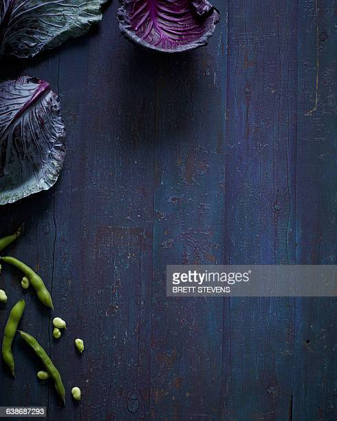 Overhead still life with seasonal cabbage and green beans