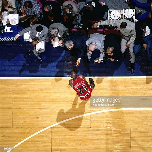 Overhead view as Michael Jordan of the Chicago Bulls talks to head coach Phil Jackson during the game against the New York Knicks in Game four of the...