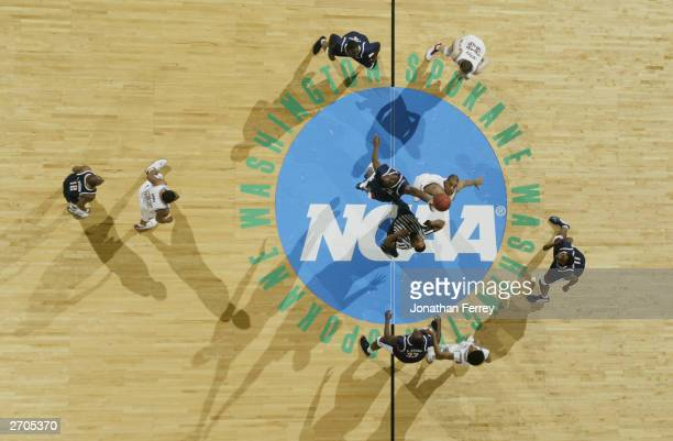 Overhead view as Rob Little of the Stanford Cardinal and Emeka Okafor of the University of Connecticut Huskies stretch at the tip off during the 2nd...