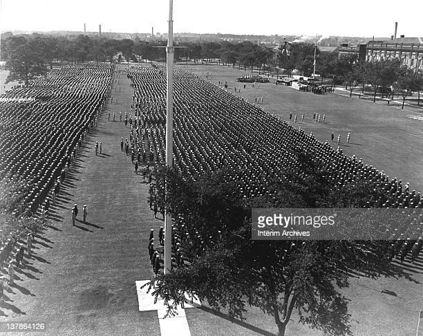 Overhead view as seen from the roof of the main administration building of ceremonies held on the parade grounds of the Naval Training Station at...