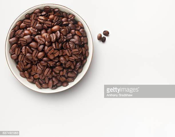 Overhead view of a bowl of coffee beans