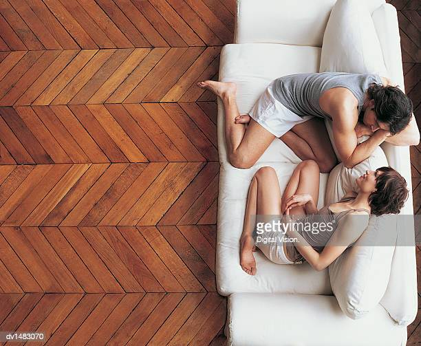 Overhead View of a Couple Sitting Talking on a Sofa