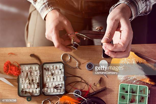 overhead view of a fly fisherman tying flies for fishing - fly casting stock pictures, royalty-free photos & images