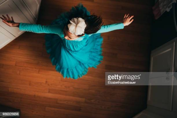 overhead view of a girl dancing - spinning stock pictures, royalty-free photos & images