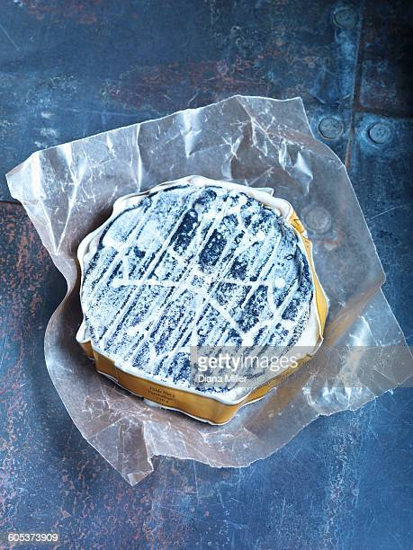 Overhead view of a goats cheese on metal table