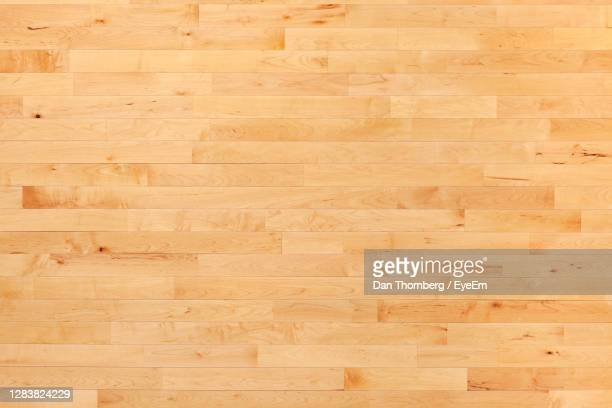 overhead view of a hardwood maple basketball floor - sports court stock pictures, royalty-free photos & images