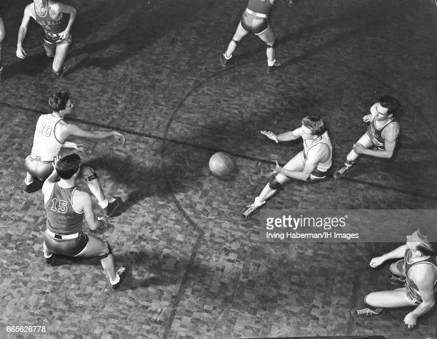 Overhead view of a men's college basketball game between Seton Hall and an unidentified opponent late 1930s