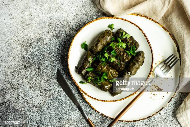 overhead view of a plate of traditional georgian tolma - dolmades stock pictures, royalty-free photos & images