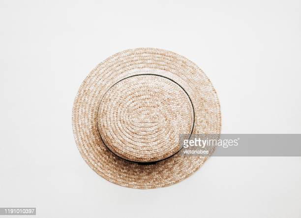 overhead view of a straw hat - straw hat stock pictures, royalty-free photos & images