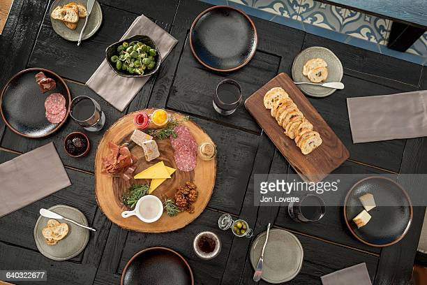 overhead view of a table set with charcuterie - charcuteria fotografías e imágenes de stock