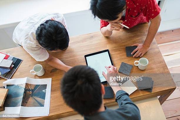 Overhead view of a team of architects having a meeting