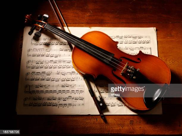 Overhead View of a Violin and Music