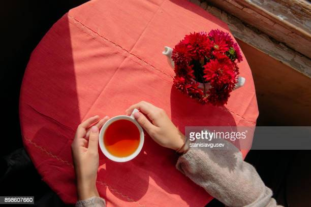 Overhead view of a woman having a cup of herbal tea