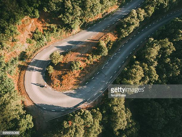 Overhead view of a woman on solo bicycle road trip