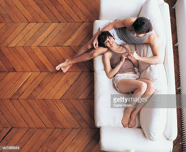 Overhead View of a Young Couple Relaxing on a Sofa