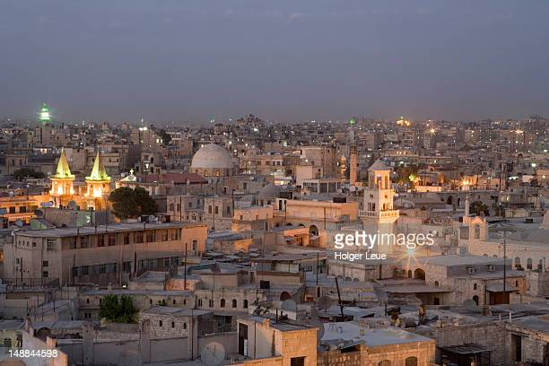 overhead view of aleppo city skyline at dusk  from rooftop of sheraton aleppo hotel. - aleppo stock pictures, royalty-free photos & images