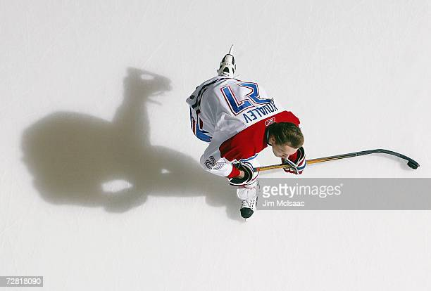 A overhead view of Alex Kovalev of the Montreal Canadiens taking a shot in warmups during their NHL game against the New York Islanders on December 7...