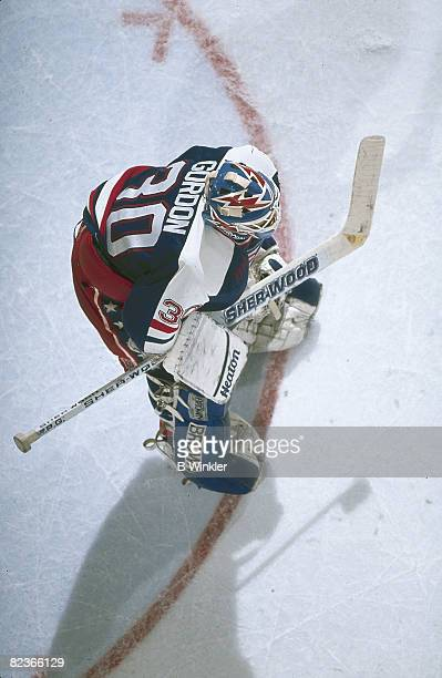 Overhead view of American ice hockey player Scott Gordon goalkeeper for Team USA as he guards the net during a preOlympics trial game October 1991