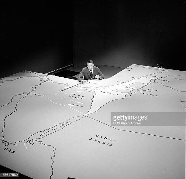 Overhead view of American television journalist Mike Wallace as he reports on the progress of what came to be called the 'Six Day War' from behind a...