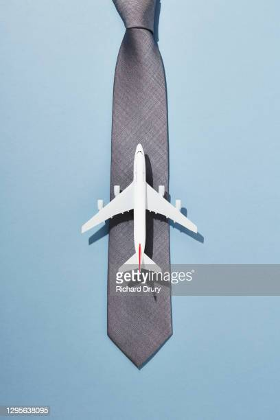 overhead view of an aeroplane on a runway made from a business tie - richard drury stock pictures, royalty-free photos & images