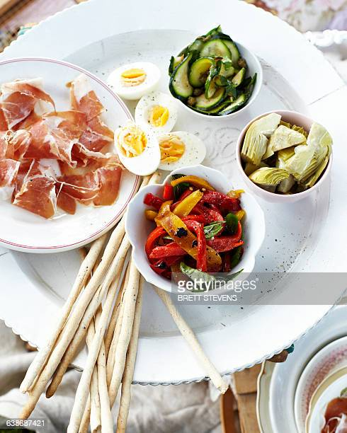 overhead view of antipasto platter on white tray - antipasto stock pictures, royalty-free photos & images