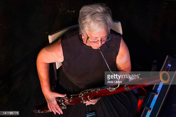 overhead view of bassoonist in orchestra - bassoon stock pictures, royalty-free photos & images