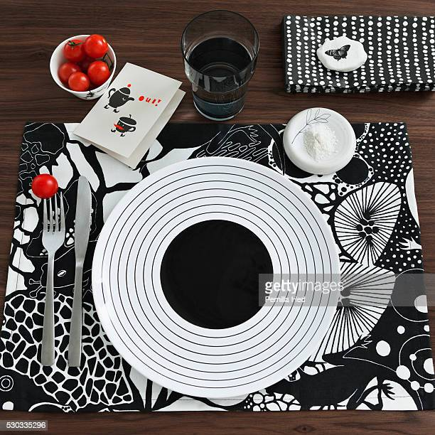 Overhead view of black and white place setting