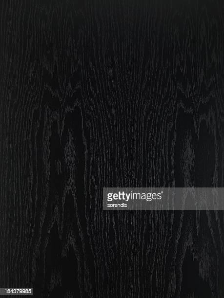 Overhead view of black wooden table