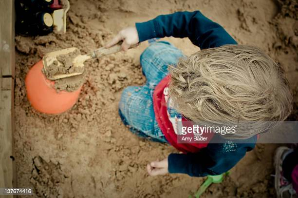 Overhead view of boy in sandbox