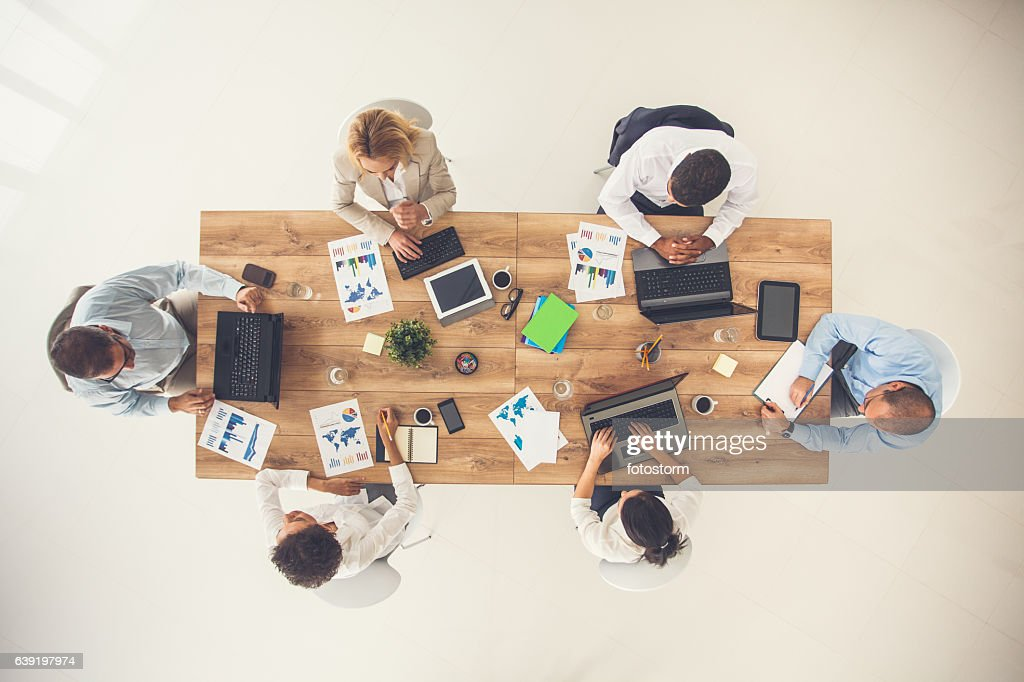 Overhead view of business meeting : Stock Photo