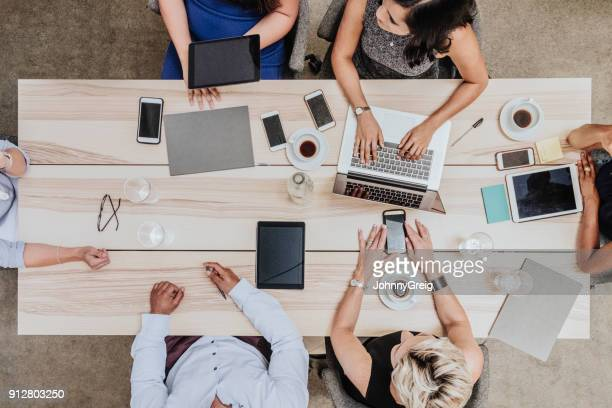 overhead view of business meeting - above stock pictures, royalty-free photos & images