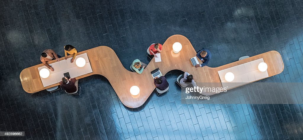 Overhead view of business meetings : Stock Photo