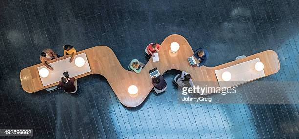 overhead view of business meetings - business finance and industry stock pictures, royalty-free photos & images
