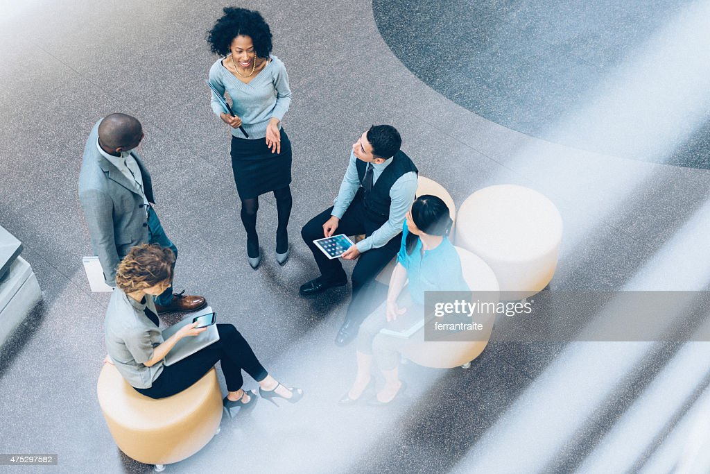 Overhead view of business people in a meeting : Stock Photo