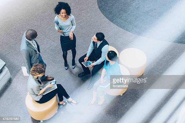 overhead view of business people in a meeting - hotel lobby stock pictures, royalty-free photos & images