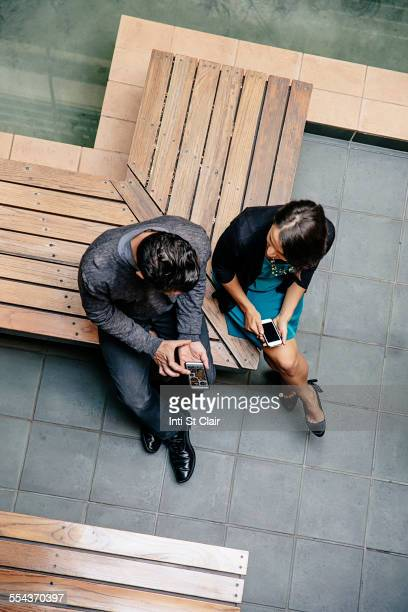Overhead view of business people talking in office courtyard